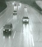Cars driving on wet motorway