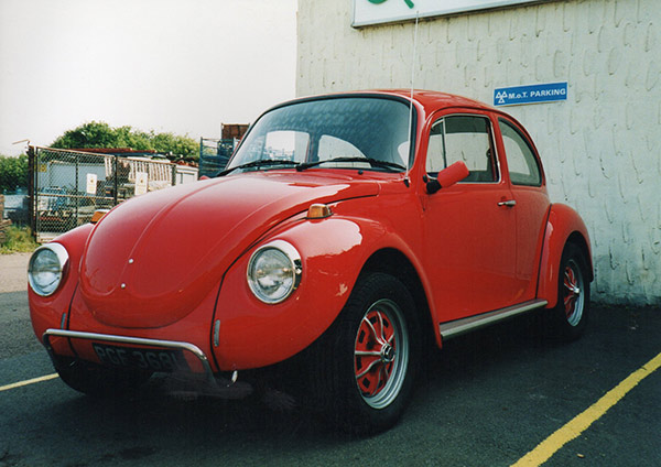 red VW Beetle at Clover Autos